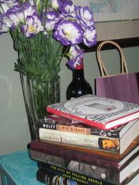 Books flowers wine